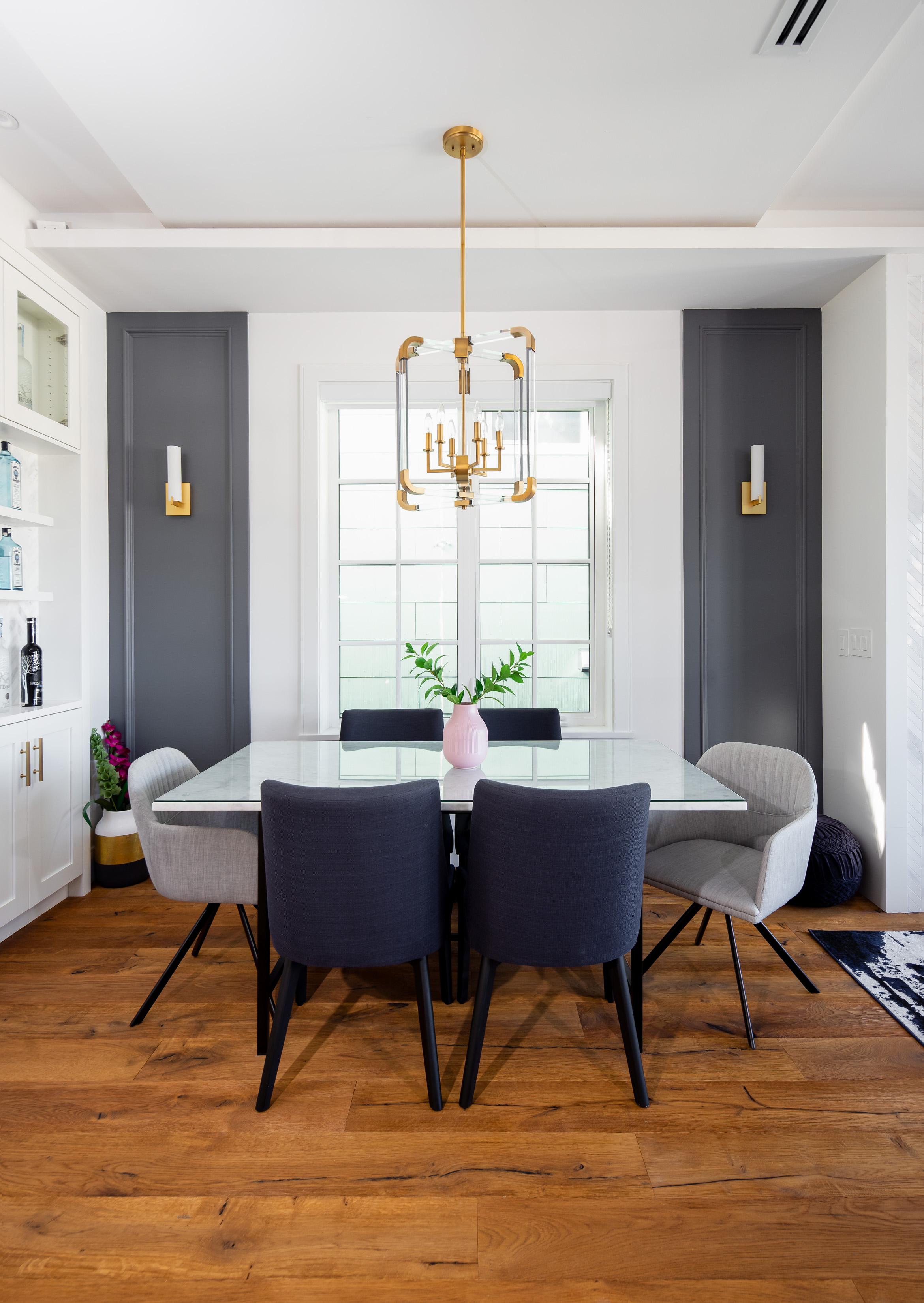 transitional dining room with gold lighting
