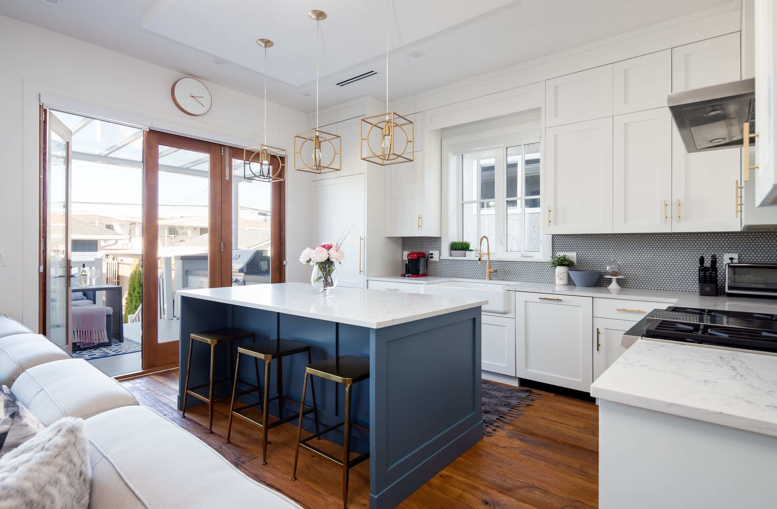 transitional kitchen with gold lighting