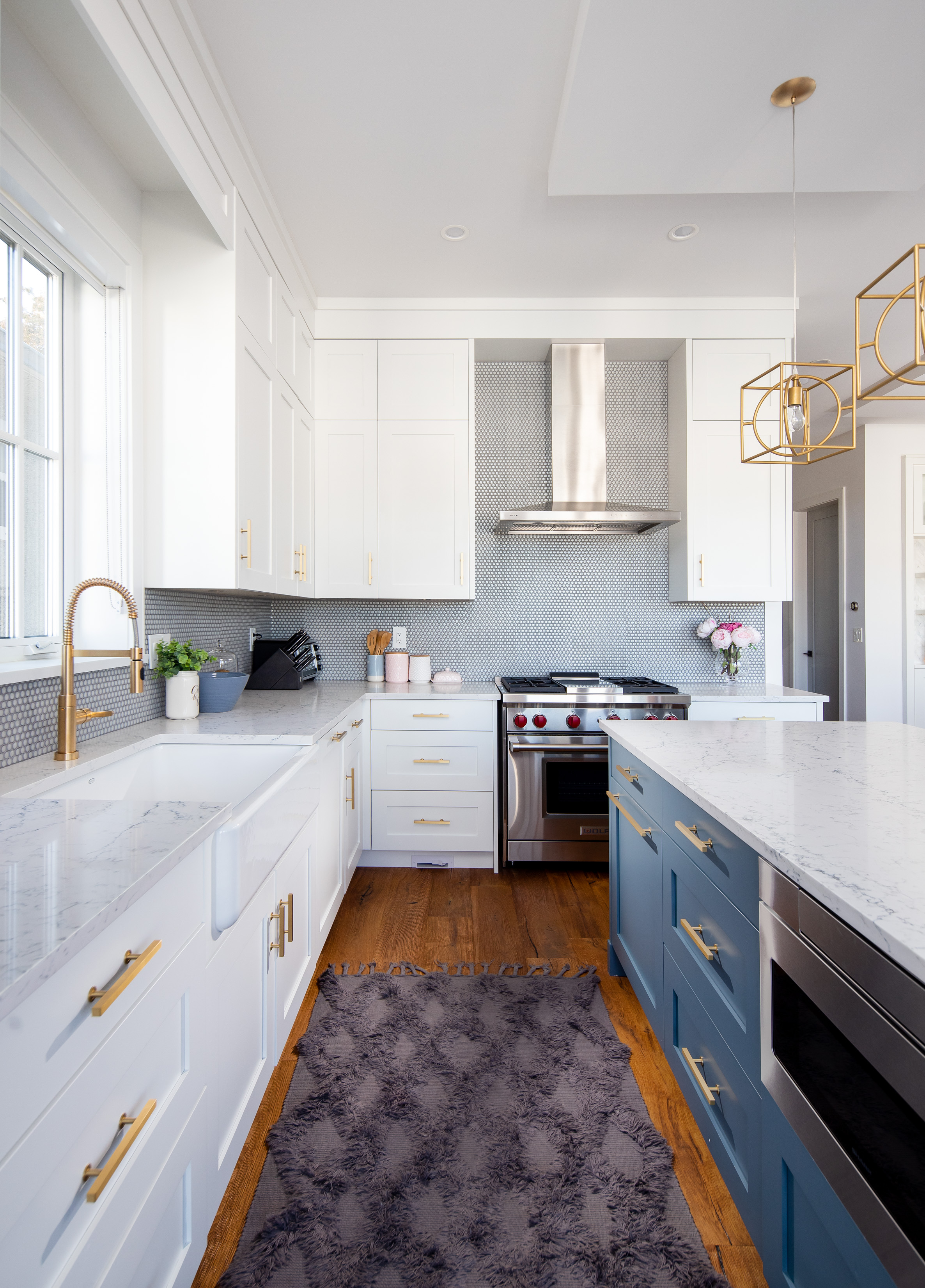 transitional kitchen with gold hardware