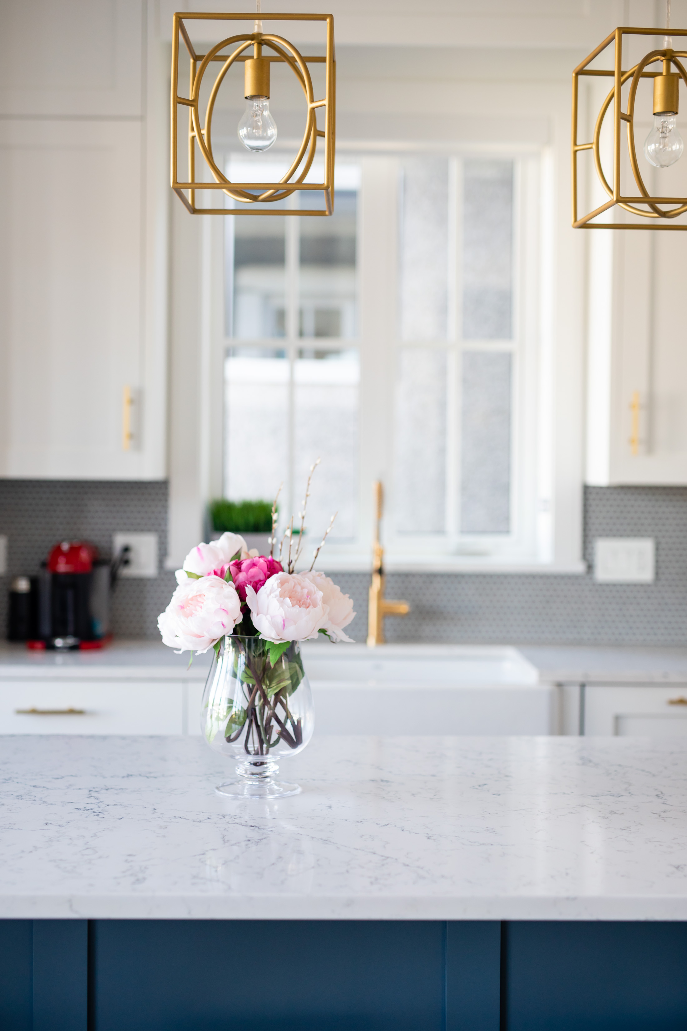 transitional kitchen with gold light pendants