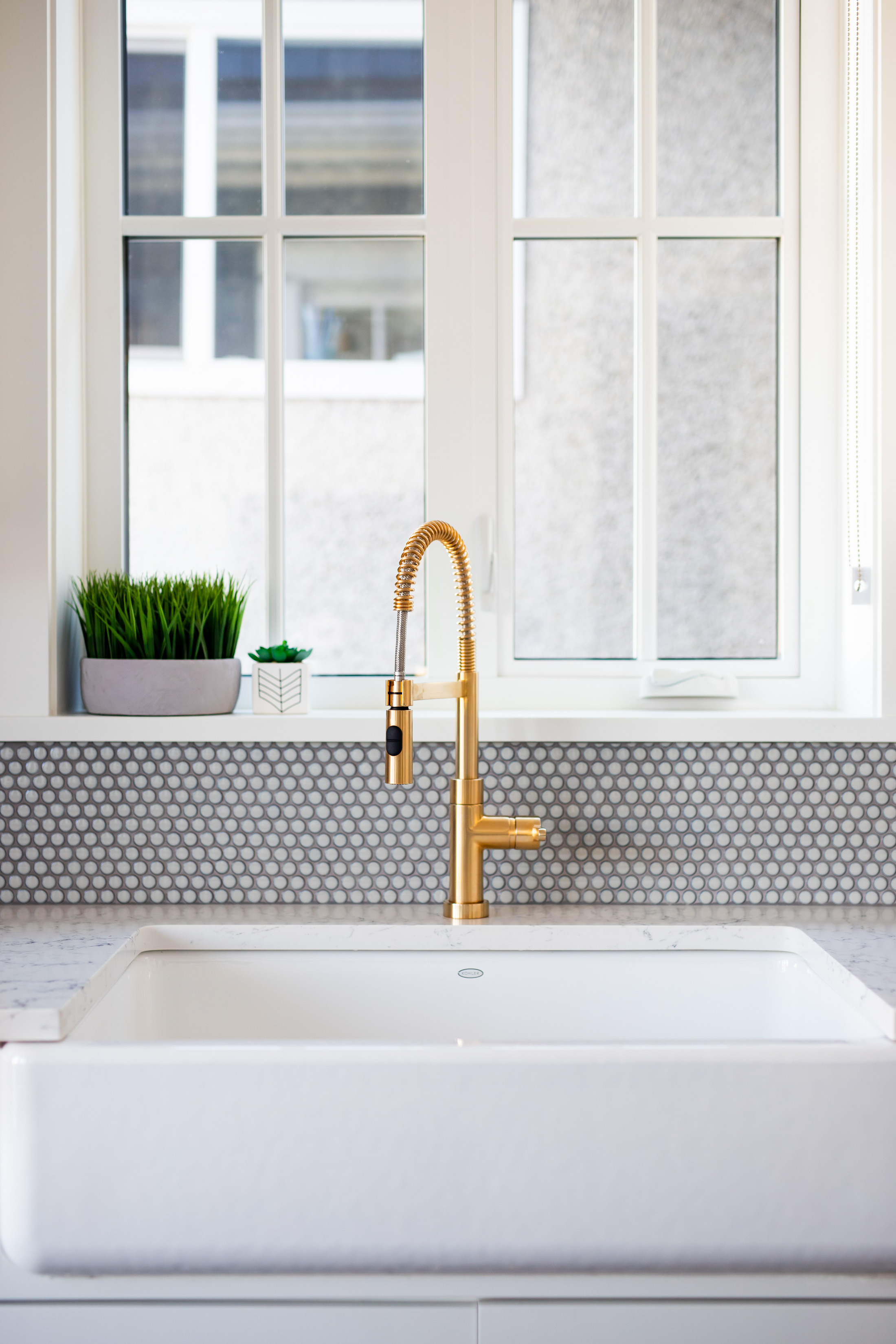 apron sink and gold faucet