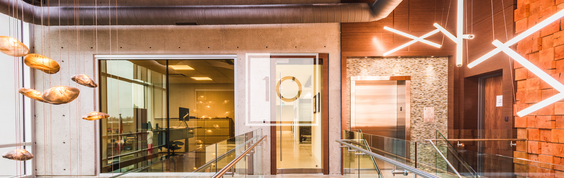 Commercial design head office hallway made of concrete, reclaimed wood, and bocci lighting