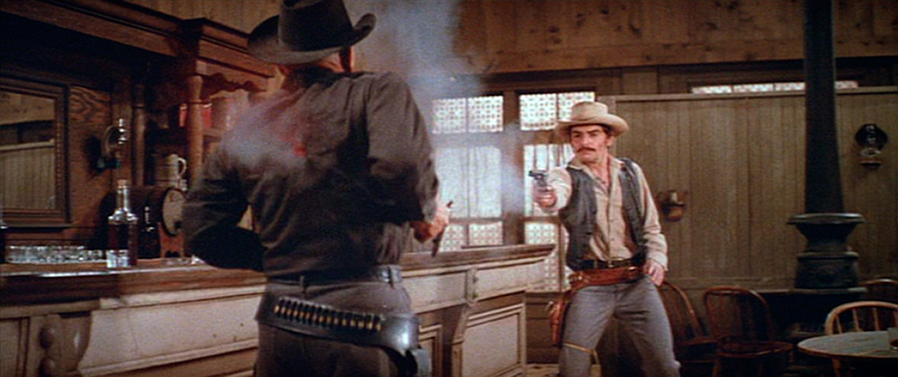A fairly realistic android gunslinger (Yul Brynner) meets his end.
