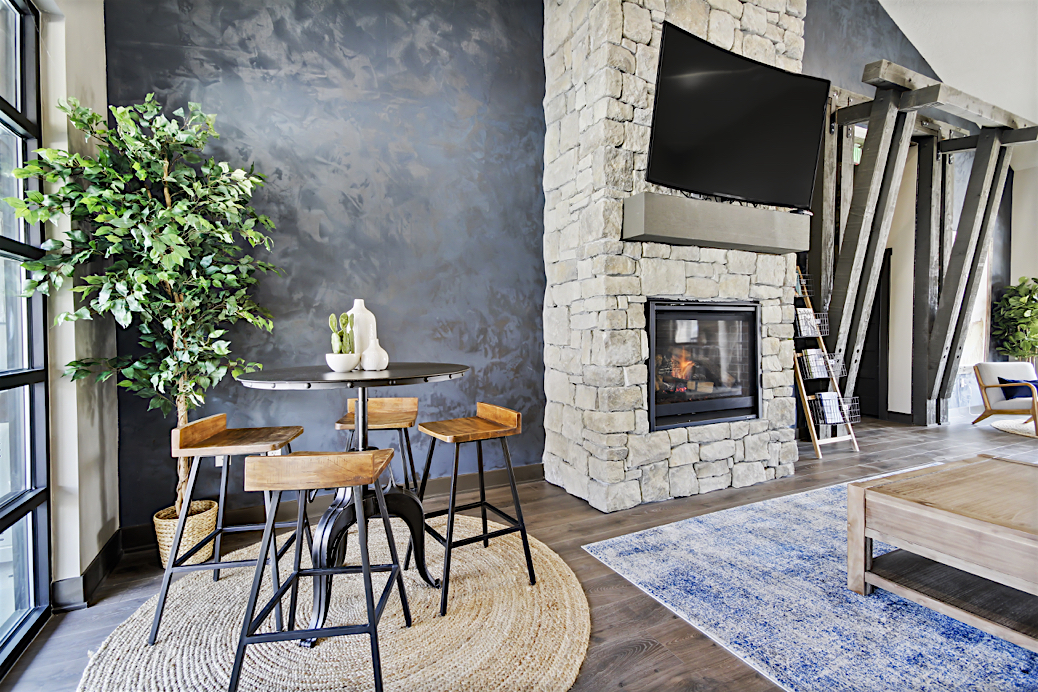 Stonesthrow-Living-clubhouse-fireplace.JPG