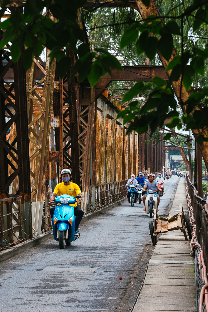 Scooters in Hanoi old quarters old railway bridge