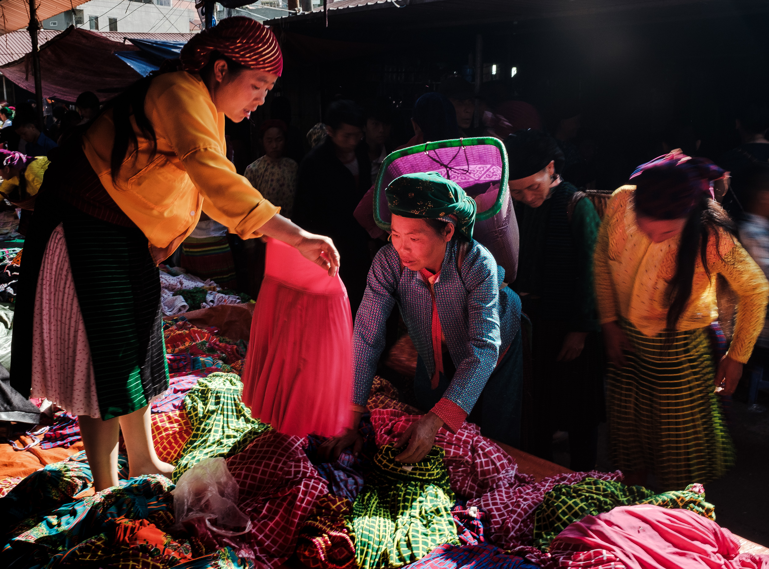 A minority woman trying to negotiate a price for the cloths in Northern vietnam Dong van market