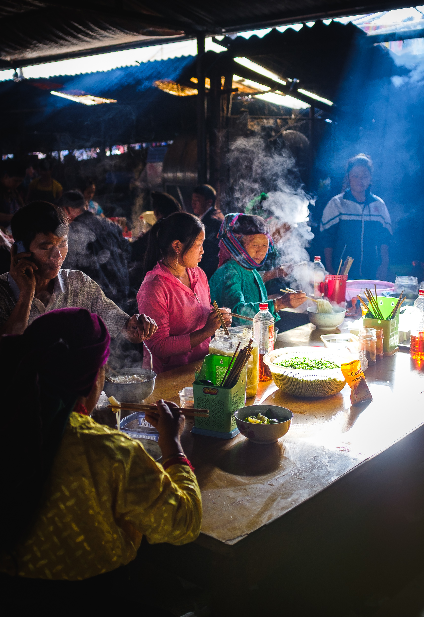 Visitors to the market having morning breakfast with Pho noodles in dong van market in Vietnam
