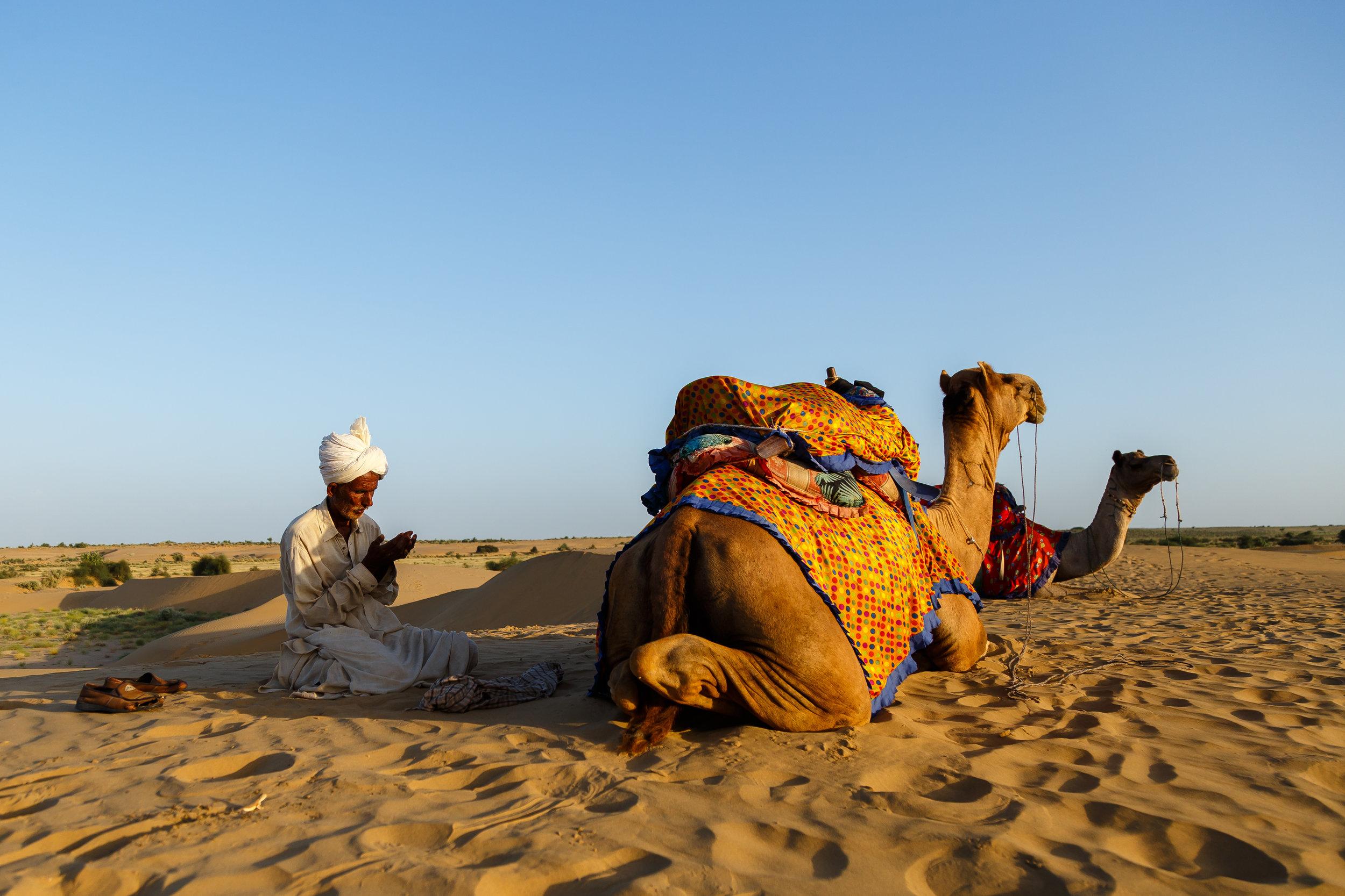 A camel rider in Sam desert dunes in Jaisalmer, Rajasthan taking