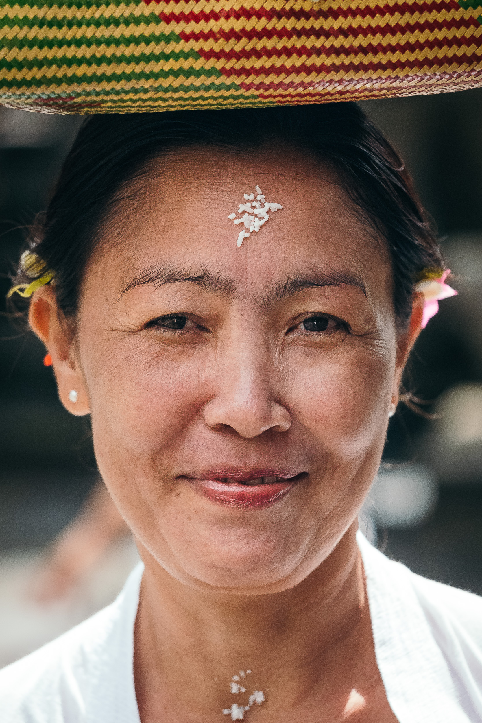 Balinese woman in traditional dress in Tirta Empul Temple in Bali, Indonesia.  Fujifilm X-T2 + Fujinon XF 80mm f/2.8 R LM WR OIS Macro