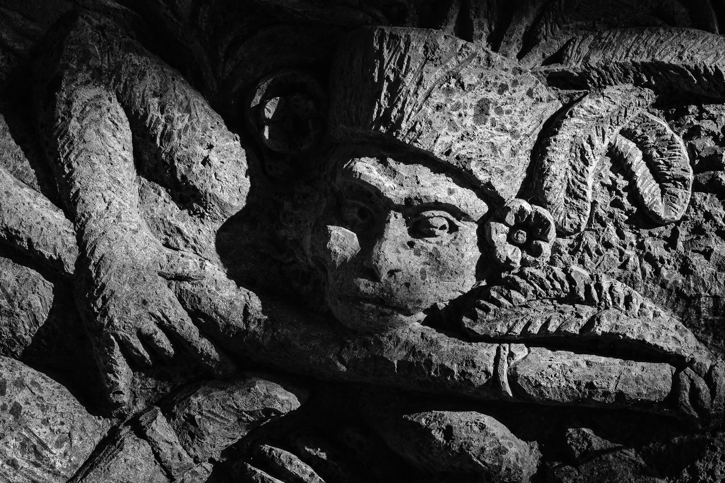 Wall sculpture in Monkey forest in ubud, Bali - Indonesia.  Fujifilm X-E3 + Fujinon XF 80mm f/2.8 R LM WR OIS Macro  1/50sec, f/13, ISO 250