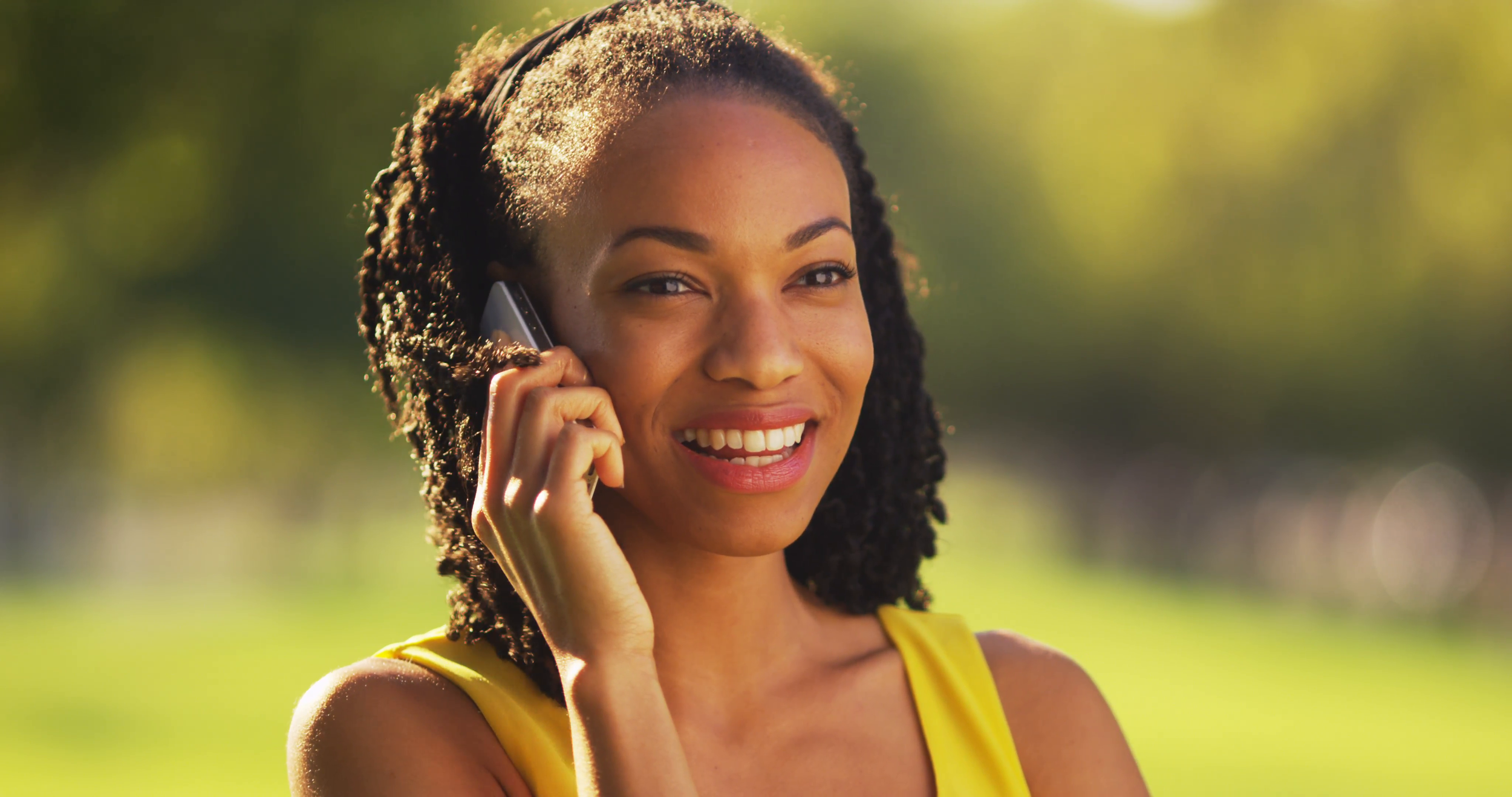 black-woman-talking-on-phone-outdoors_njy3ghrfx__F0000.png