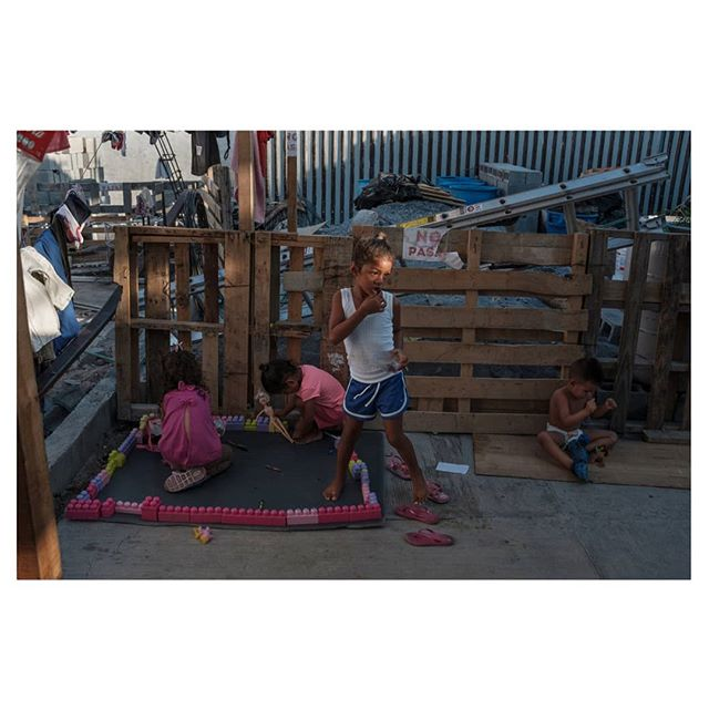 """Central American migrant children play at a shelter in Nuevo Laredo, Tamaulipas, the lastest border city where the """"Remain in Mexico"""" program was applied. The U.S. policy forces asylum seekers to wait in the city known for its high levels of crime while their cases wind through clogged immigration courts.  Outtake from a recent assignment for the @nytimes ________________ #fronterasur #documentary #photojournalism #photo #color #migration #usa #mexico #migracion #chiapas #nyt #guatemala"""