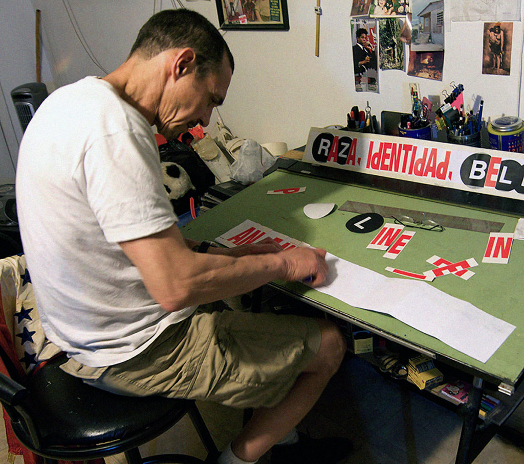 """Diaz at work on his """"WET PAINT"""" collages."""