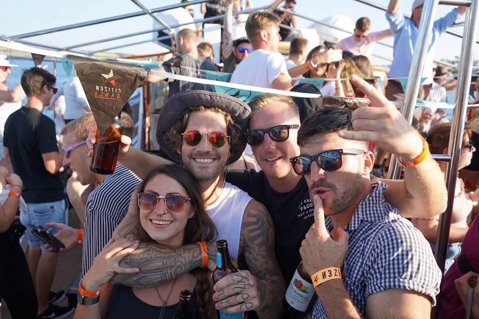 Big smiles loving the live music aboard a boat hire