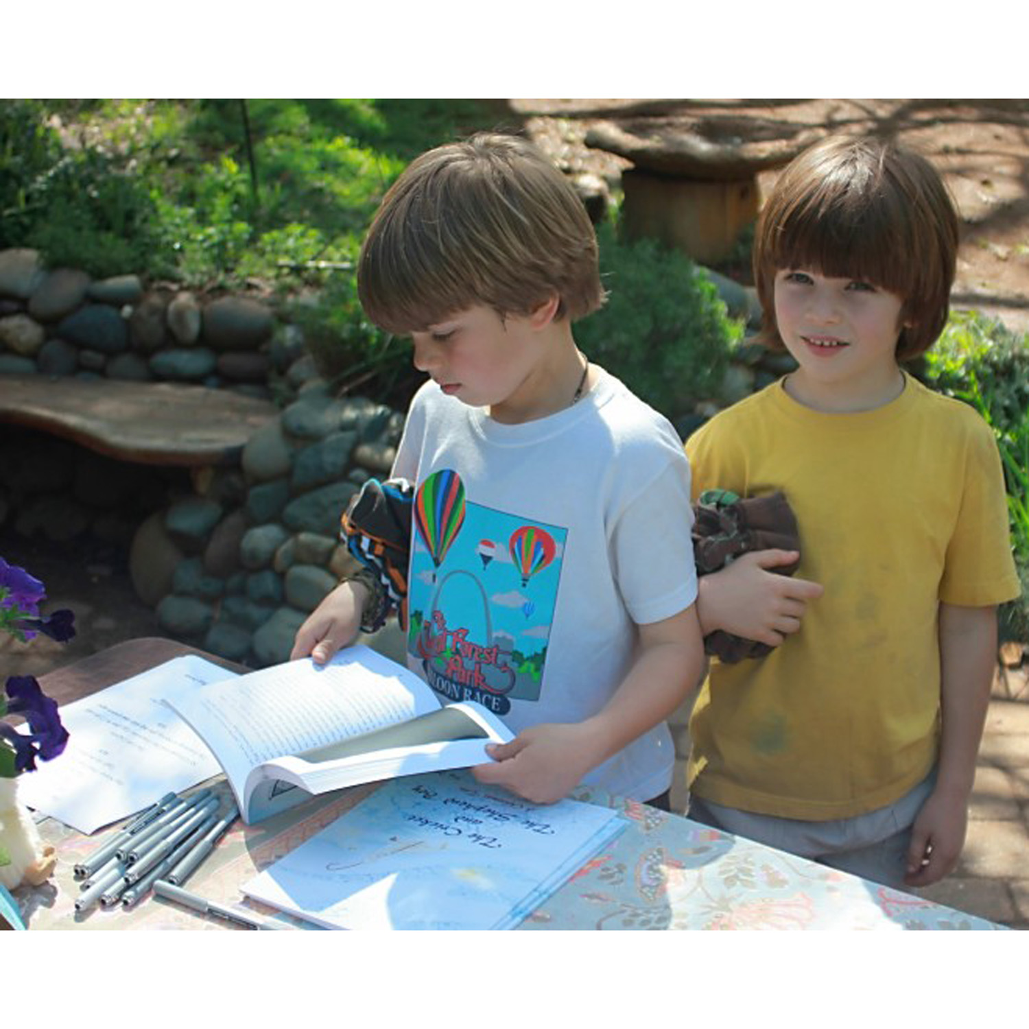 two boys check out the books :)