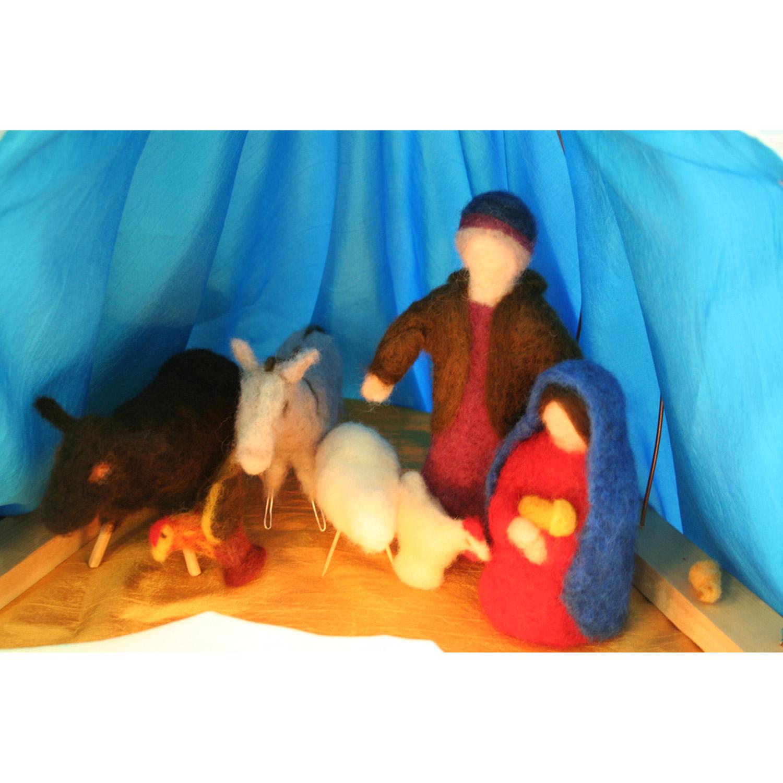 The Sun Child inside the manger.