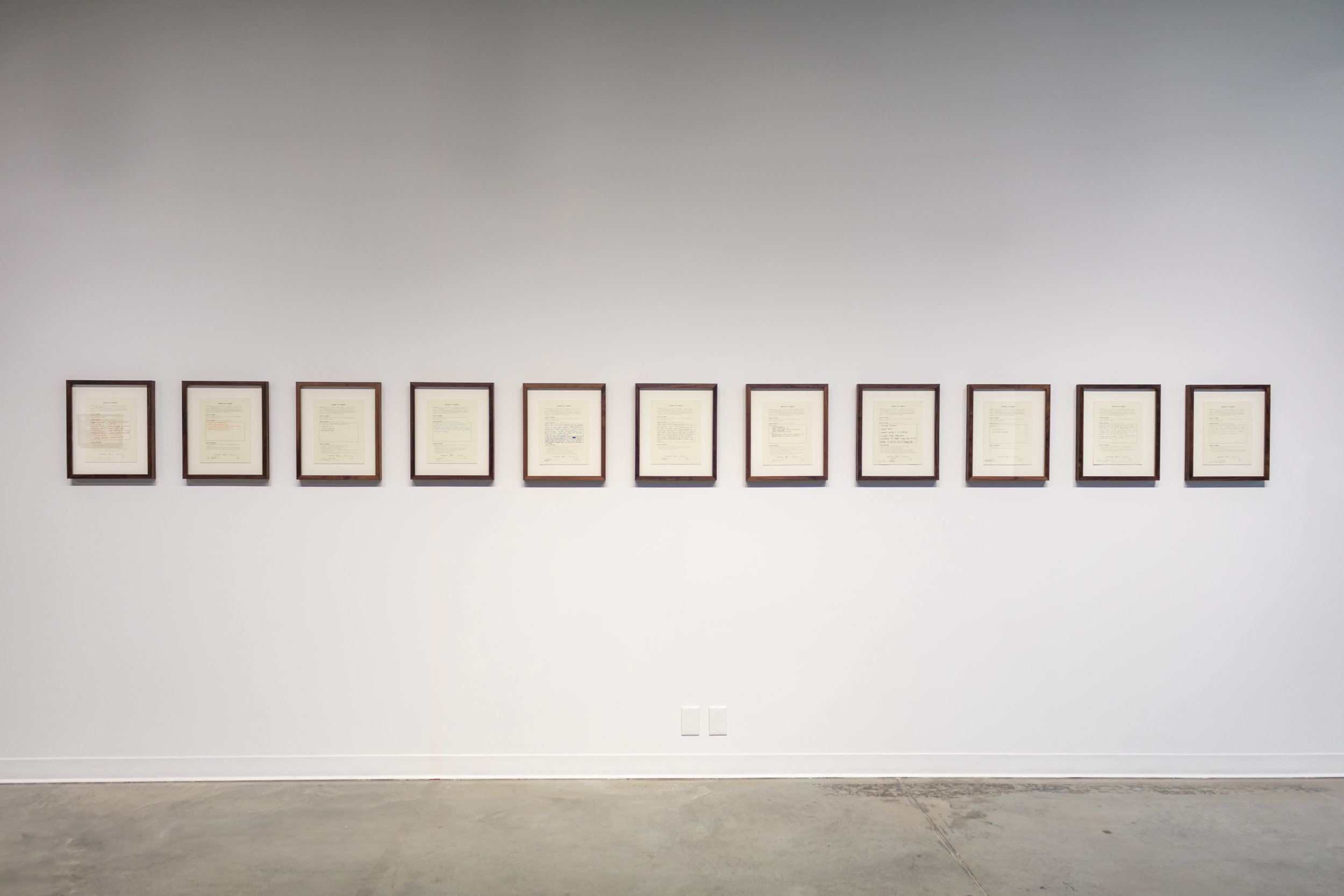 """11 signed contracts of emotional, physical and/or conceptual labour; 14"""" x 16"""" Walnut frames"""