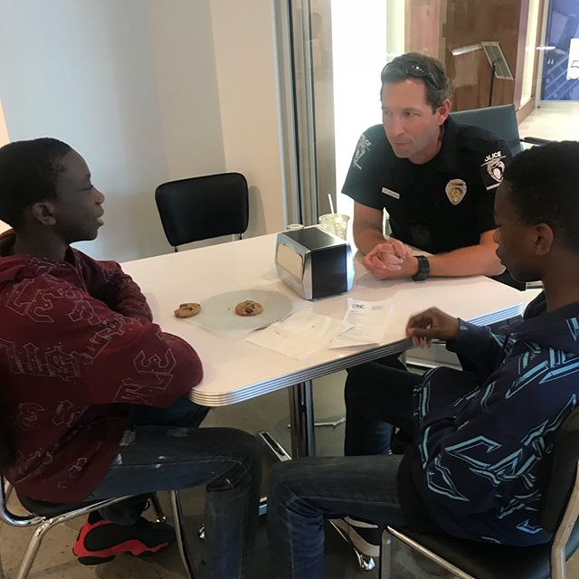 Behailu Academy students enjoying coffee and conversation with Charlotte Mecklenburg Police Department police officers at Joe and Nosh. 👩🏽‍✈️☕️👨‍✈️ #CoffeeWithACop #BehailuAcademy #StrengthOvercameObstacles