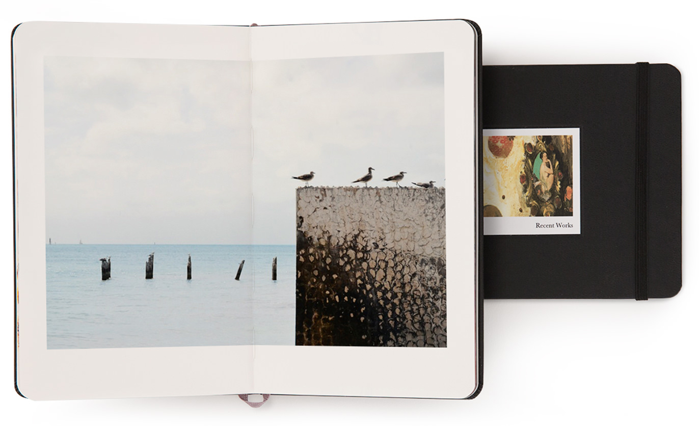 Why not add a gorgeous Moleskine photobook to your packages? - Or two?