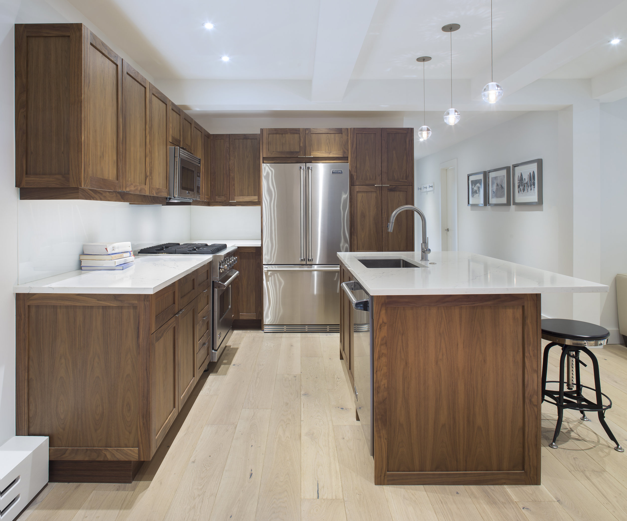 Custom Kitchen Design and Fabrication - A timeless and clean design featuring walnut shaker doors and panels, Viking appliances and a simple aesthetic that maximizes the small space.