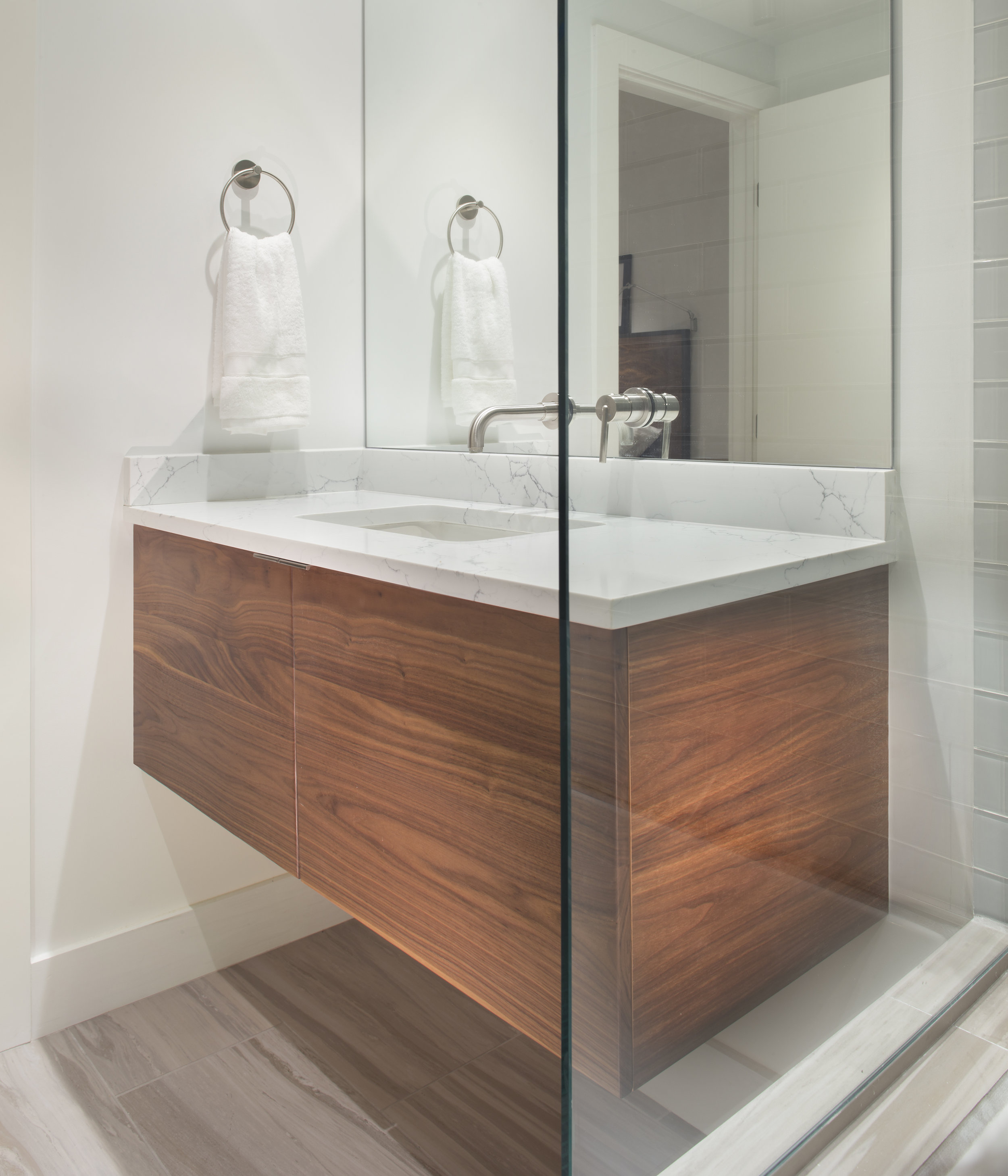 Custom Walnut Vanity - A walnut floating vanity with concealed drawers and a simple, clean aesthetic. Solid walnut face and soft-close hinges