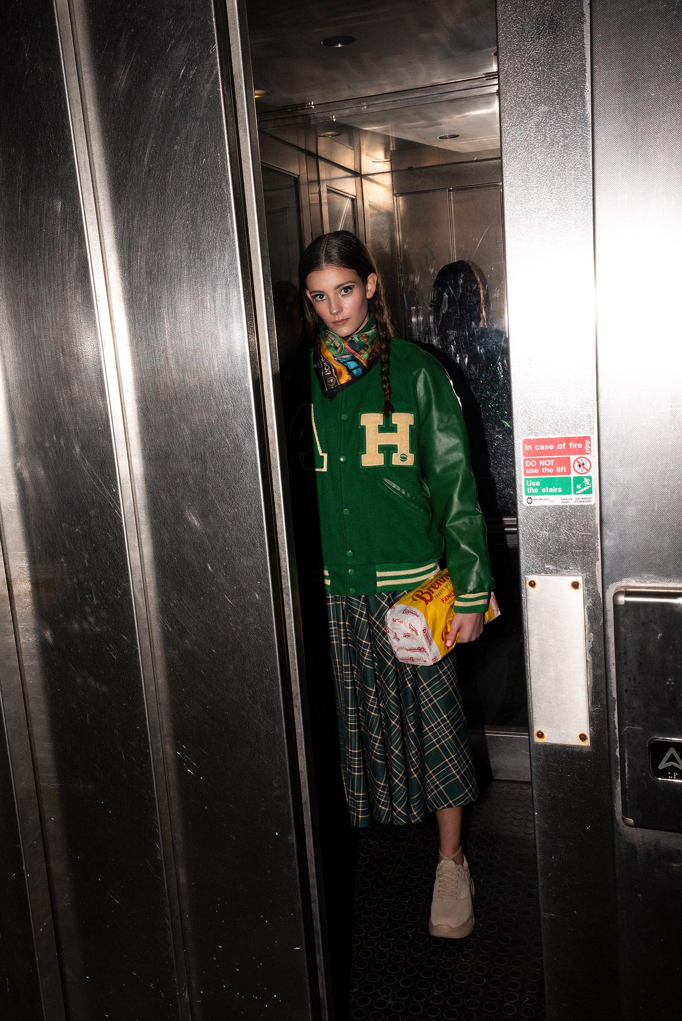 Final-look-skirt-and-baseball-jacket-in-elevator-5928.jpg