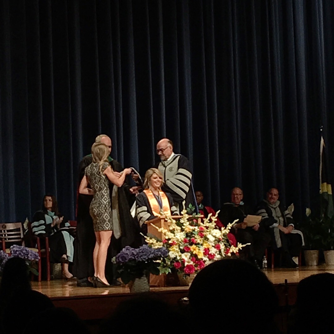 Dr. Shanele Lundahl hooding the new Dr. Libby Paskey, April 2016.