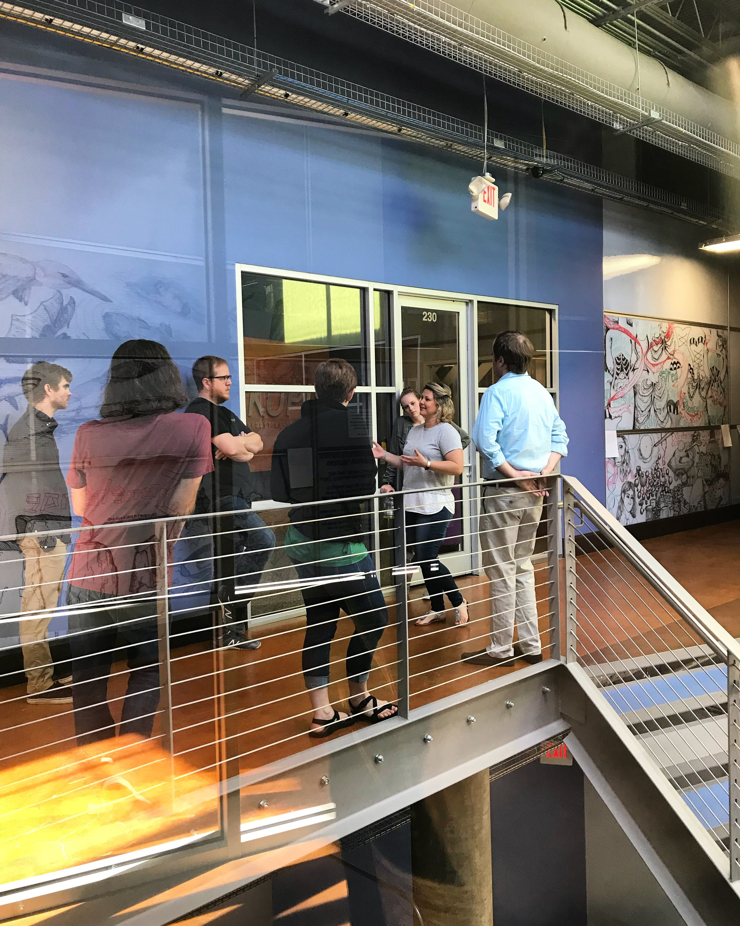 NEXT operations manager Christy Ashkettle giving Carolina Code School students a tour