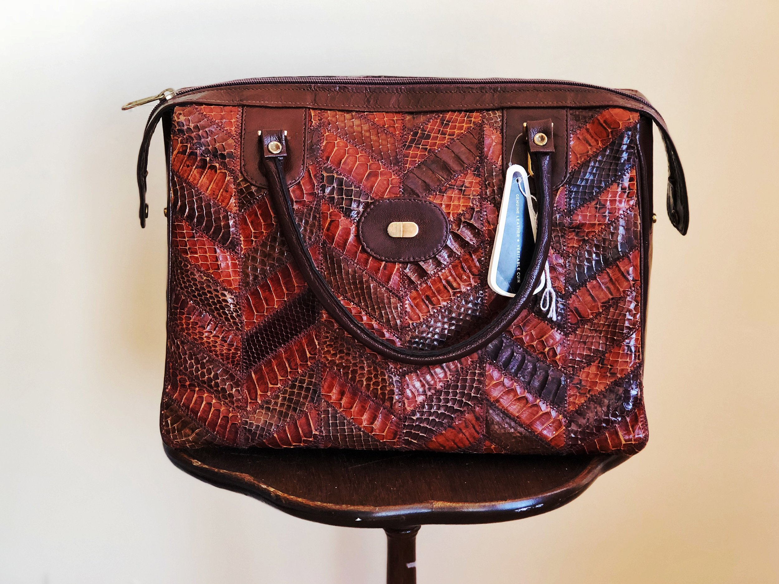 This gorgeous vintage La Belle snakeskin handbag still has the original tags. Made in Montreal in the 1970s. Proof that quality and classic style are timeless.