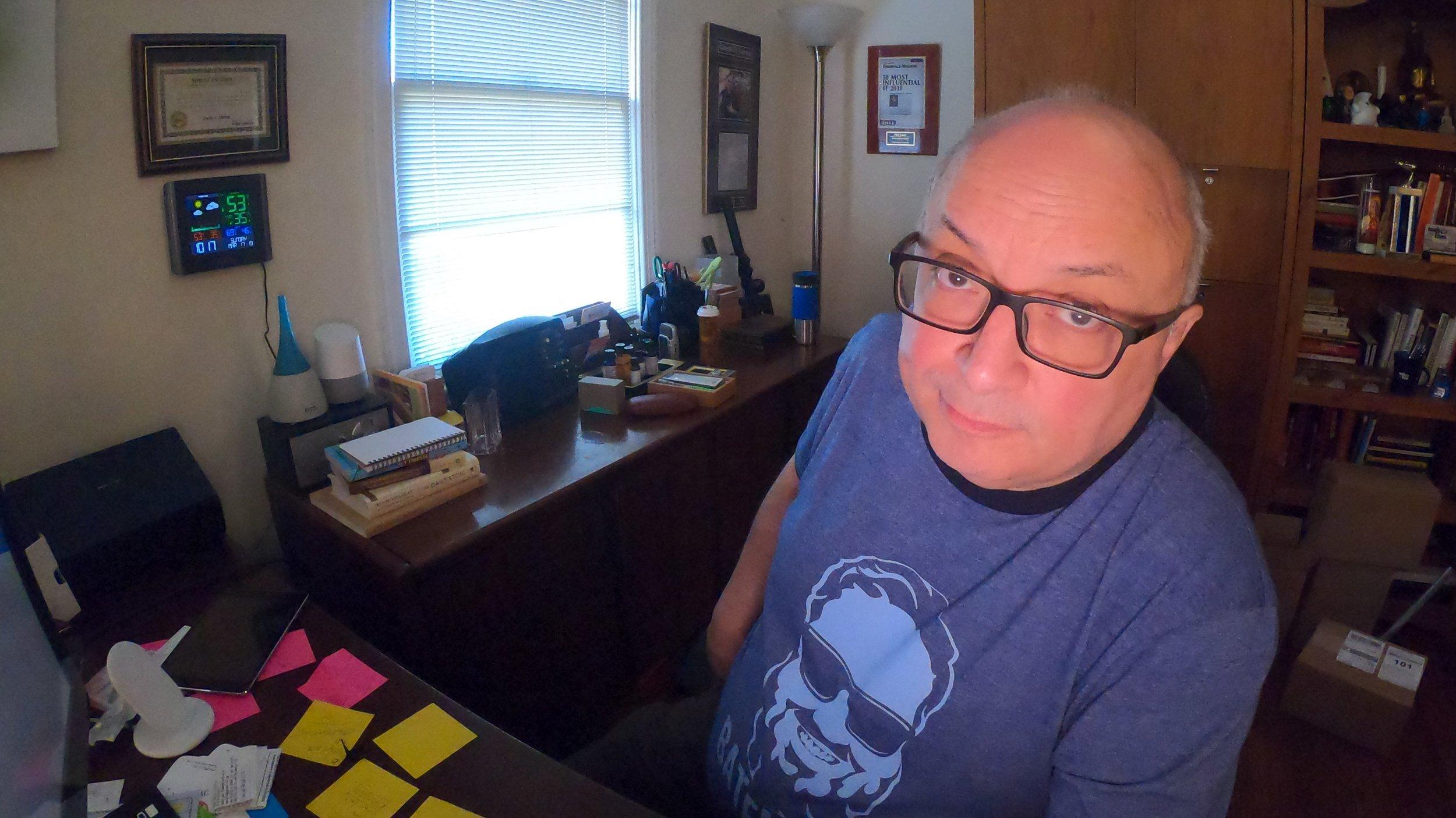 Phil Yanov recording a podcast.