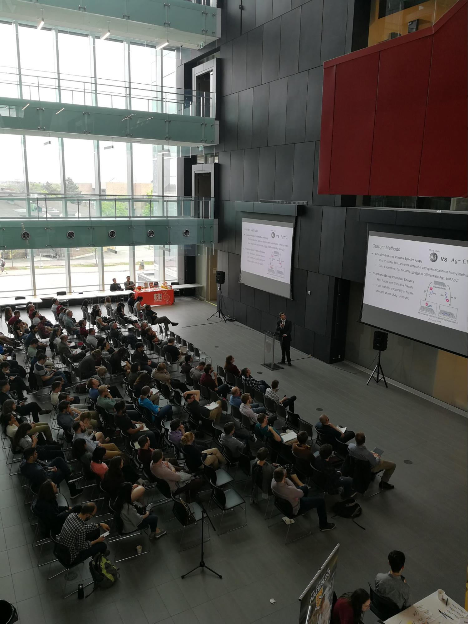 Adam Radek Martinez delivering his (award-winning) research talk at SynBio 4.0. Photo courtesy of    @Synbiosymp    and    WCMR  .