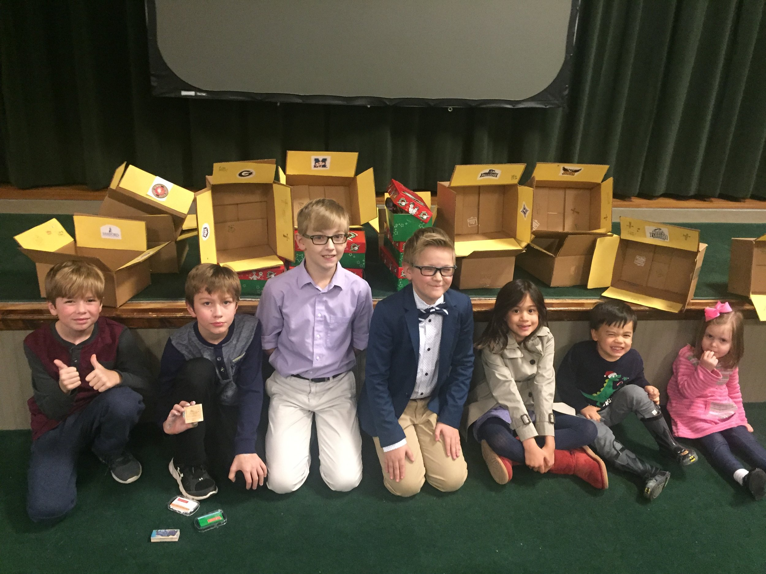 The children decorated care packages and wrote notes of encouragement for the church's college students and filled 6 shoeboxes for Operation Christmas Child.