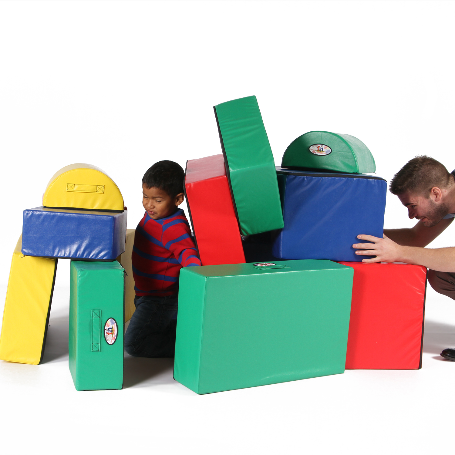 Father playing with son on Foamnasium foam play set.
