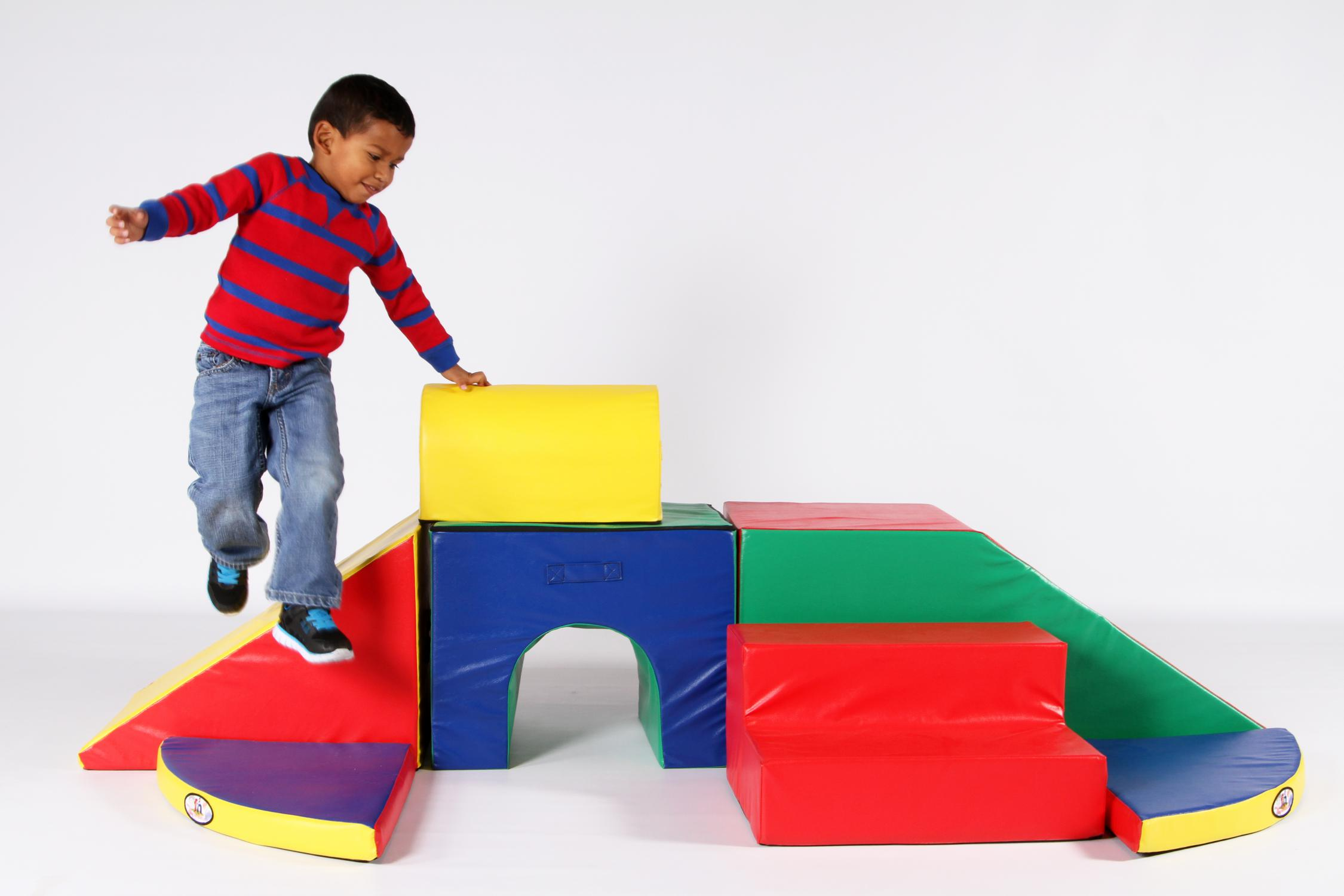 Preschool boy playing on Foamnasium foam play set.