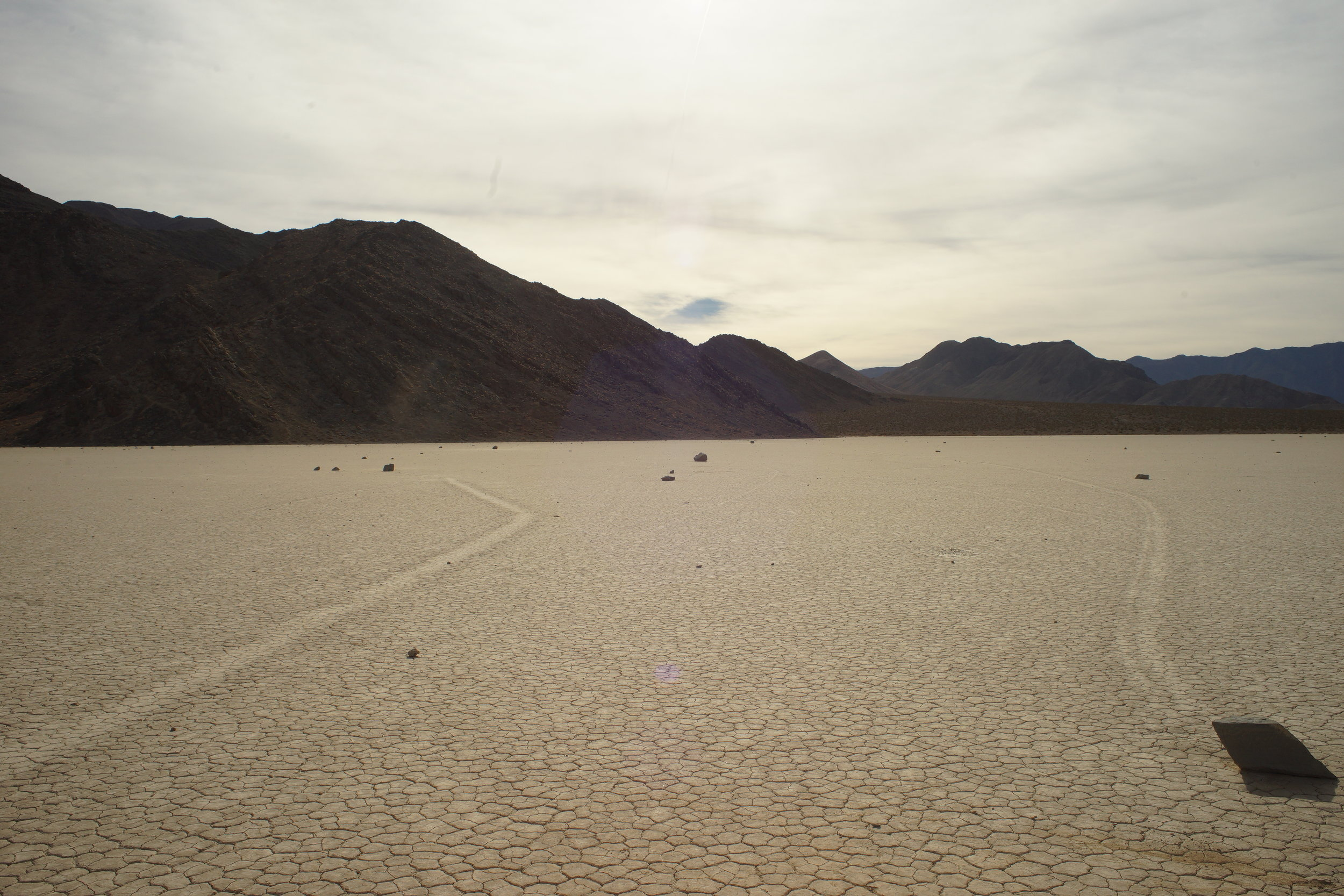 Moving rocks in the Racetrack, Death Valley.