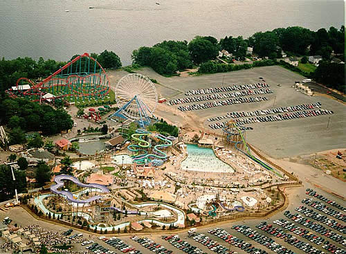 Here is a view of the section of Six Flags New England where the large ferris wheel and the water park, Hurricane Harbor,reside. It must have been a pretty warm day, given all the people in the tidal pool. In the background are boats zipping by on the Connecticut River.