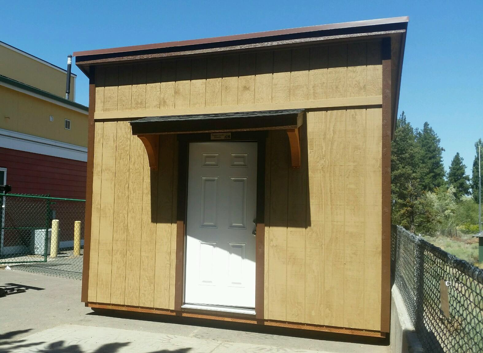 We built this cute shed with an eyebrow and curved corbels for Desert Sky Montessori Charter School in Bend.
