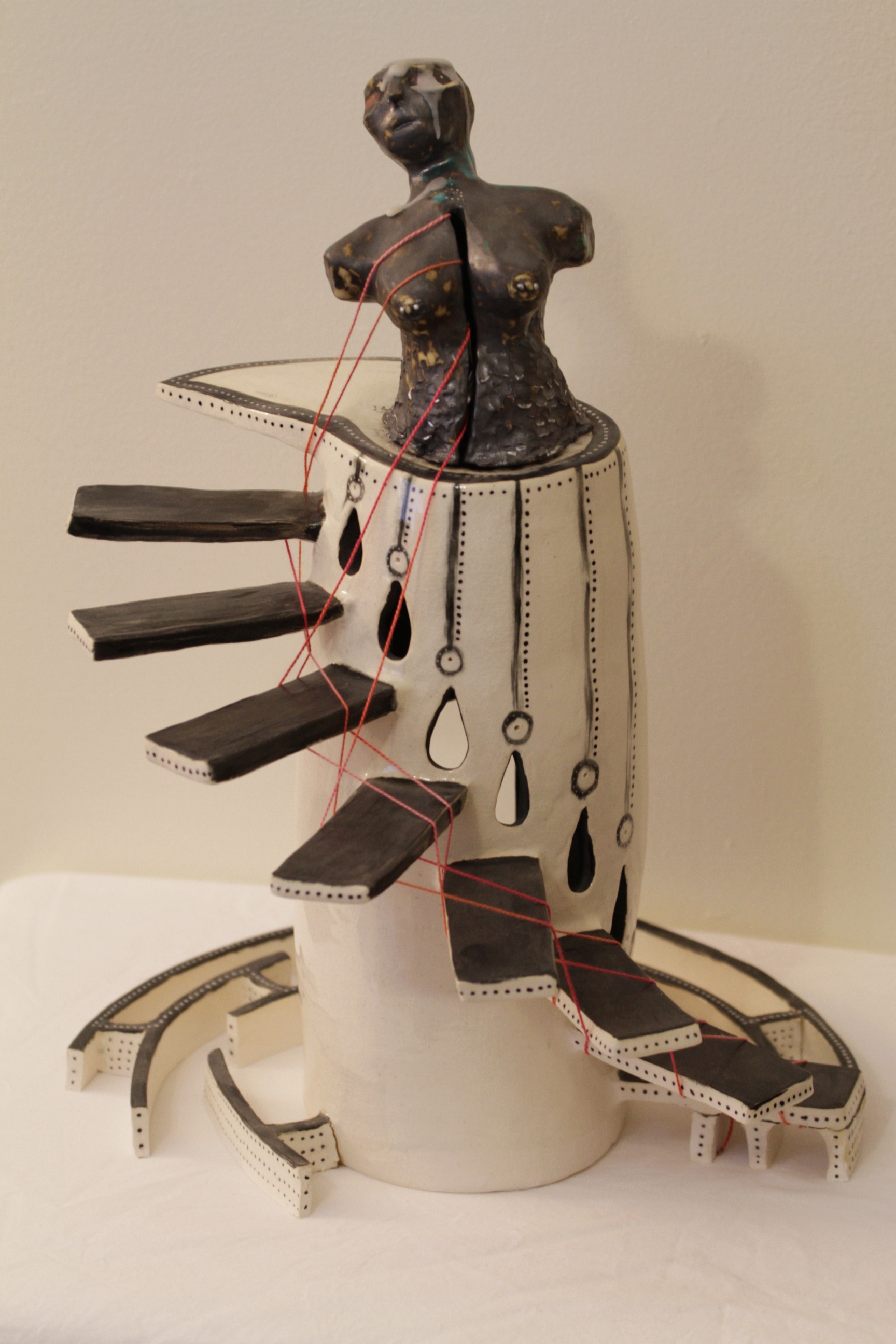 I Was Burned Before Birth , 2016. Ceramic, glaze, thread, wax, marker, and hidden element.  A work created at the beginnings of a journey of self-discovery beyond the gender binary.