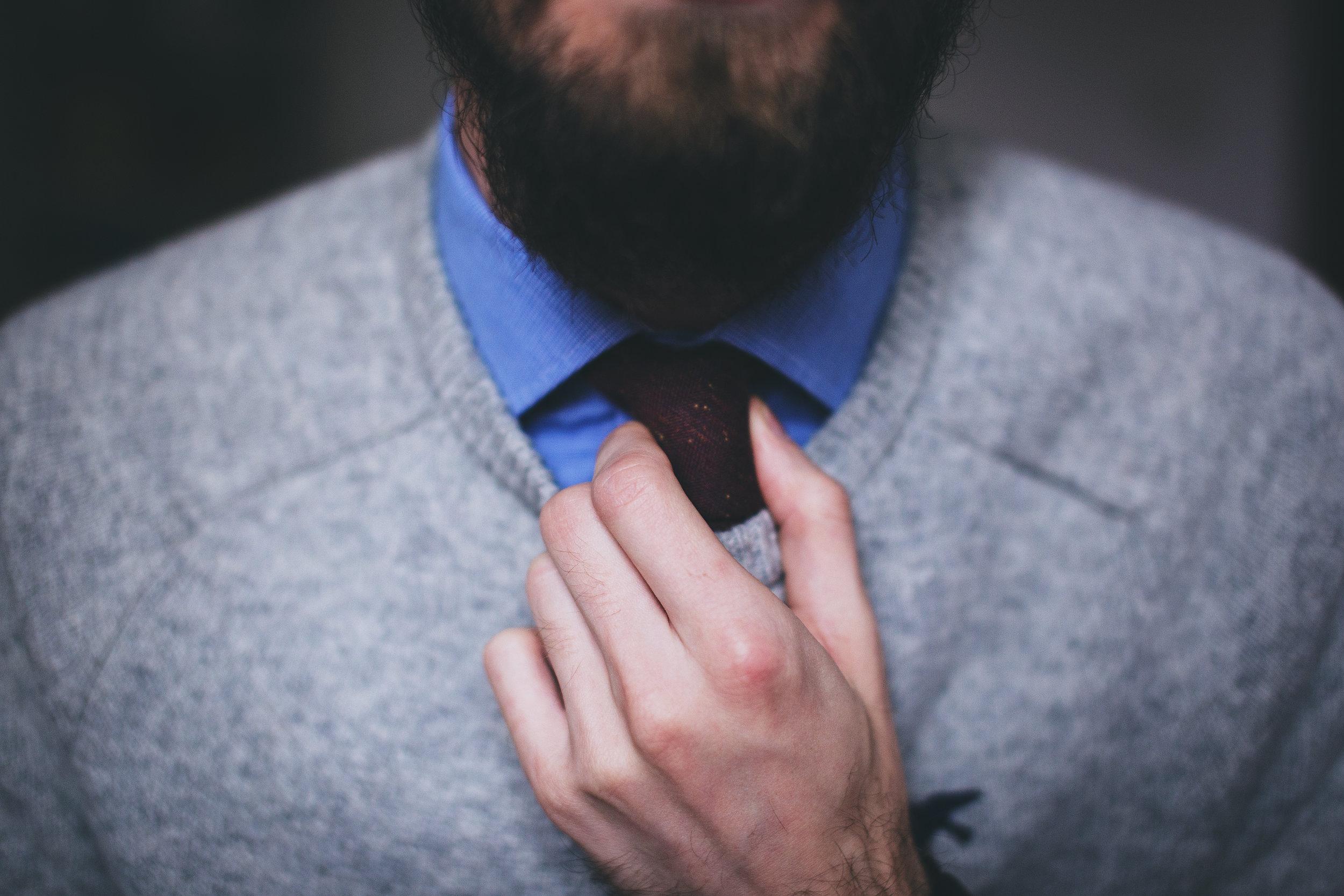 Canva - Man Wearing Gray Top Fixing Red Necktie.jpg