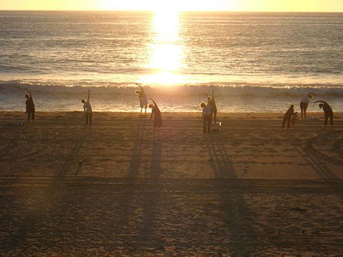 Yoga class on the beach with Kathleen Conklin