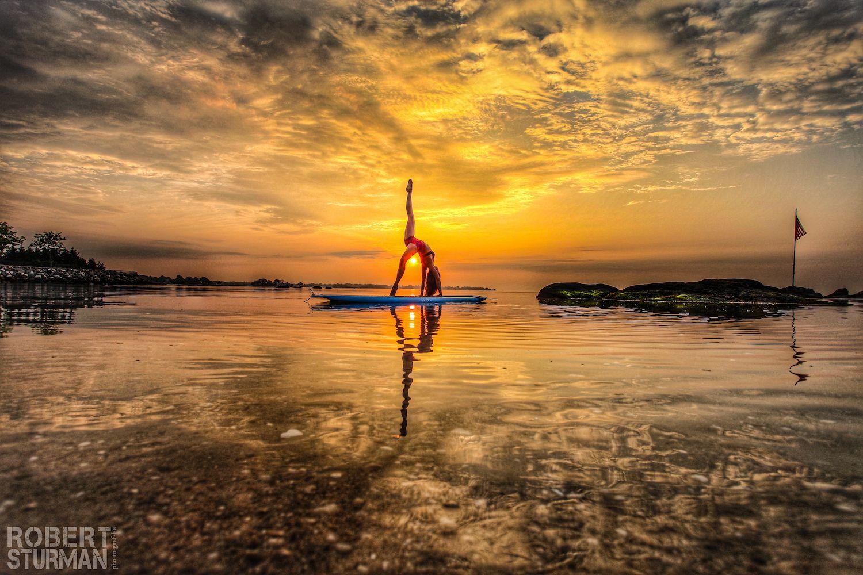 Robert Sturman photograph of a yoga pose on the water