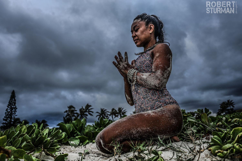 Robert Sturman photograph of a woman meditating in the sand