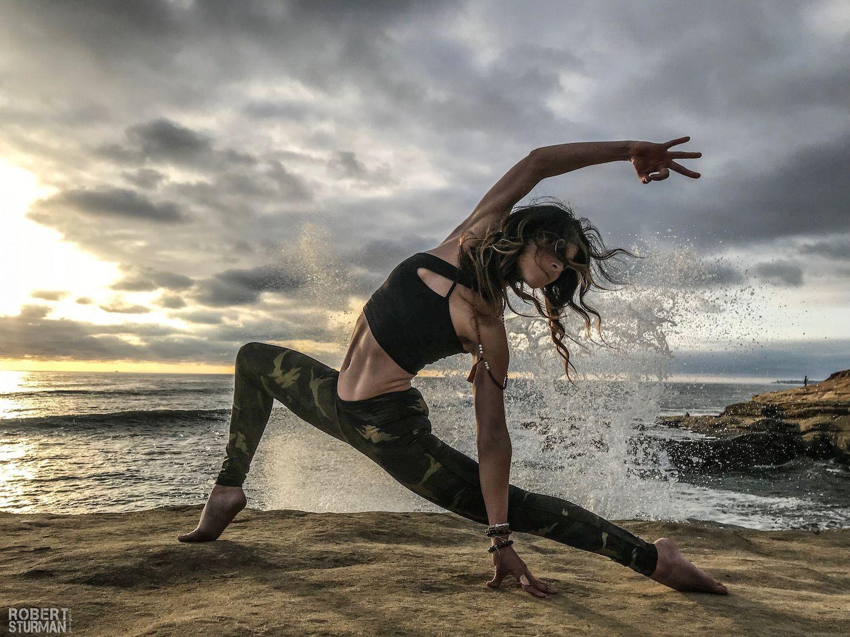 Robert Sturman photograph of a yoga pose on the beach