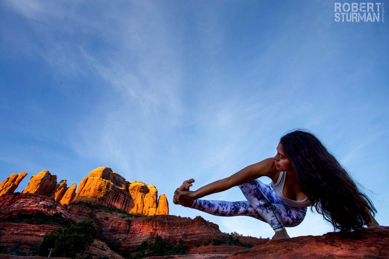 Robert Sturman photograph of a woman doing yoga in the desert