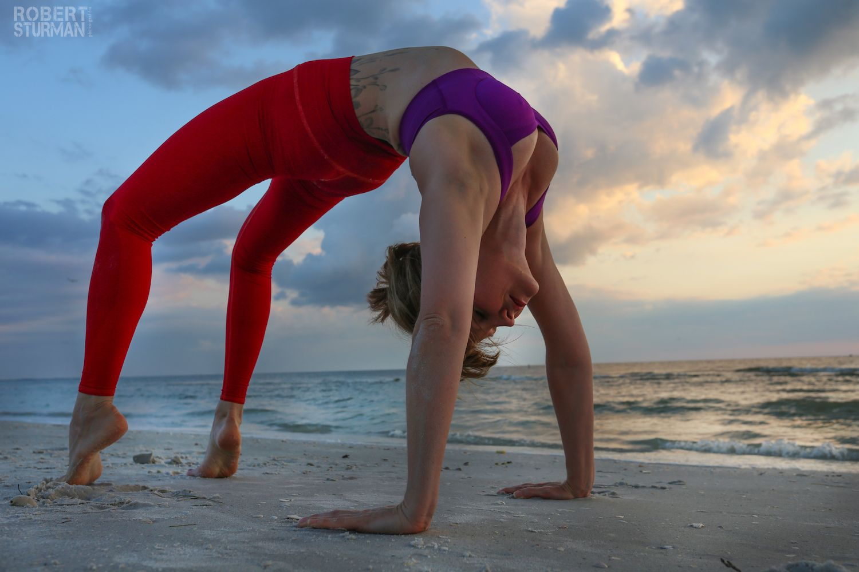 Yoga bridge pose on the beach, photo by Robert Sturman