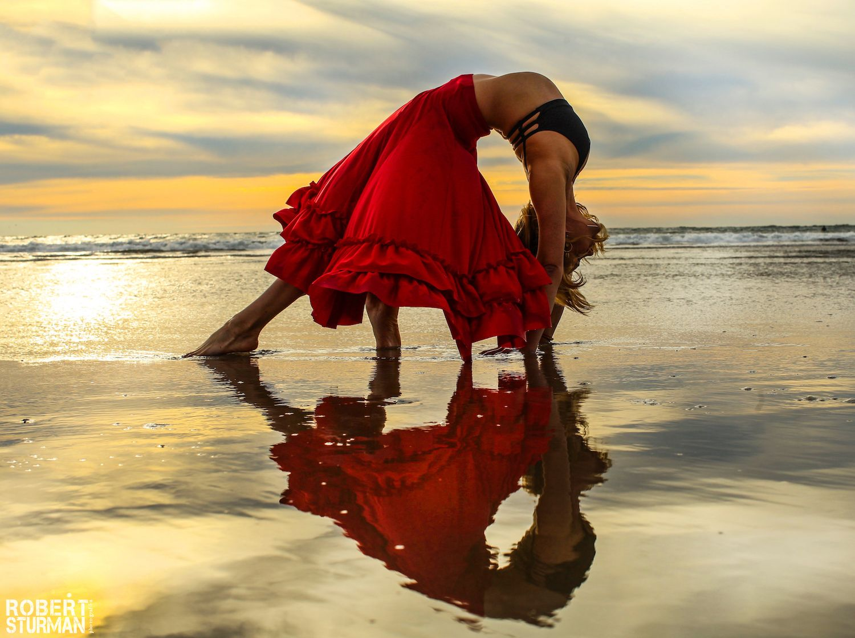 Woman doing yoga on the water, photo by Robert Sturman