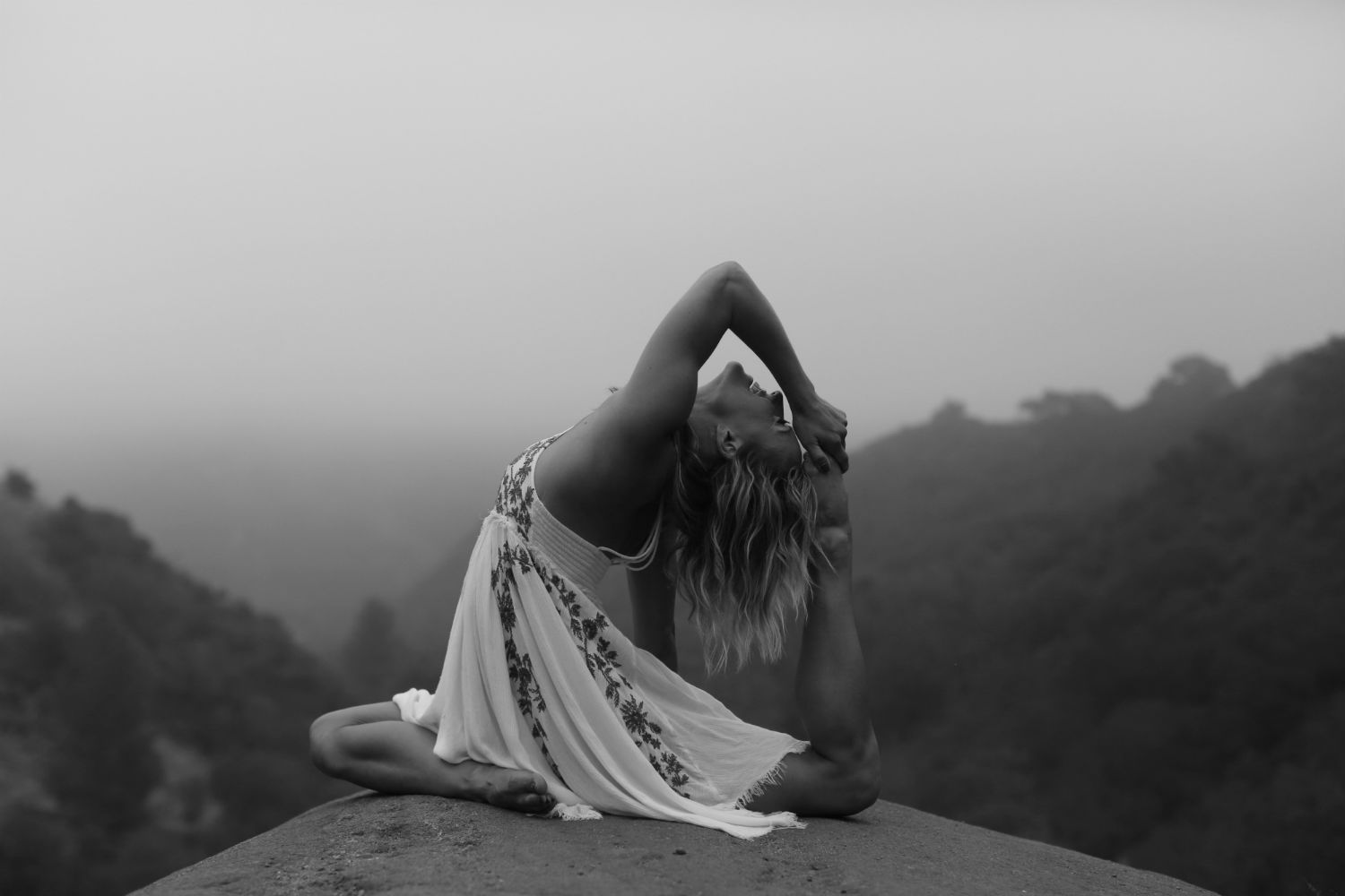 Yoga pose on a hilltop by Chelsey Korus