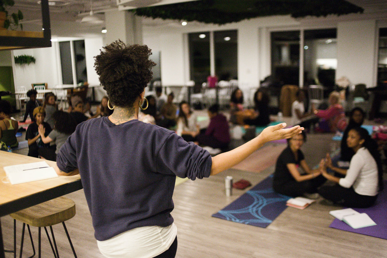 Alex Elle teaching a writing workshop