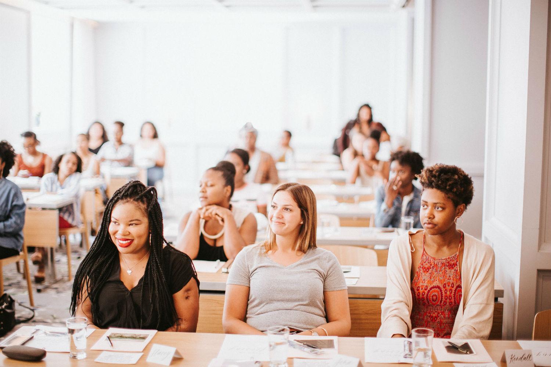 Participants sitting in workshop session at Alex Elle retreat