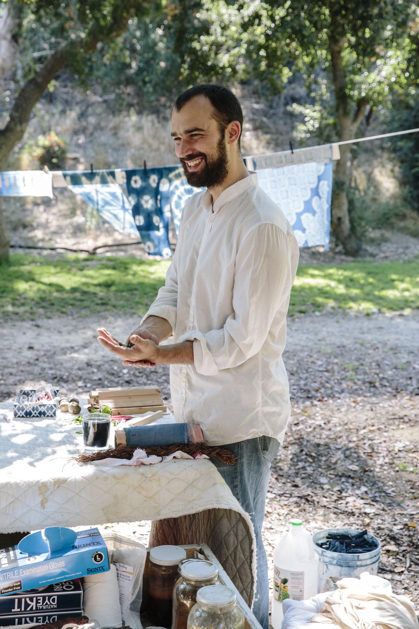Graham Keegan teaching indigo dye extraction